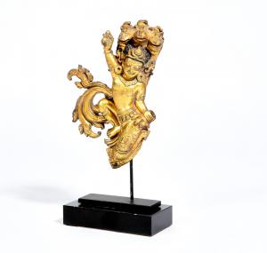 16th/17th century Tibetan repoussé gilt copper model of a Nagaraja on a stand, height 8in (20cm), width 5 1/2in (14cm), estimate $3,000-$5,000.