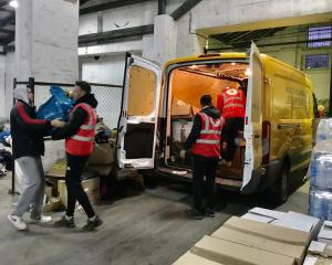In Croatia, the Red Cross helps unload supplies collected by Volunteer Ministers in Italy
