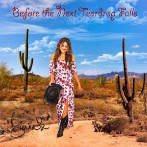 Latin Country Artist Dianña in flowing dress on dirt desert road