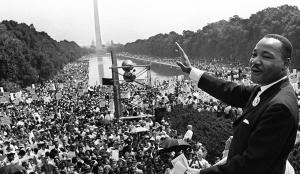"Martin Luther King Jr. delivering the ""I Have a Dream"" speech at the 1963 Washington DC Civil Rights March on the steps at the Lincoln Memorial"