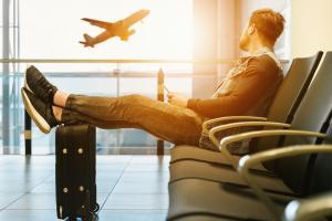 Matthew Keezer sitting at the Airport