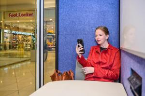 Woman in ZenSpace Pod at Westfield Valley Fair Mall Meeting Workspace Ondemand smart URW