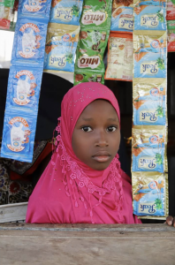 Photo of girl in market by Terna Atsor