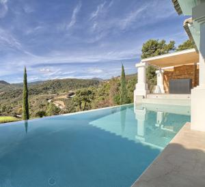 Expansive terraces & direct access to outdoor infinity pool