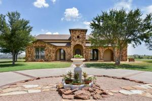 """3,670± sq. ft. 4 bedroom 3 bath, 3 car garage home on 1.9± acres,"""" said Ryan Rickles, auction agent.  """"Notable features include a bonus room; storm shelter; kitchen w/conveying stainless Wolf appliances, subzero fridge and wine room"""