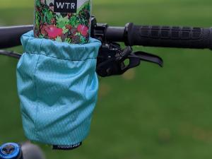 HandleStash cup holder in blue color holding water bottle