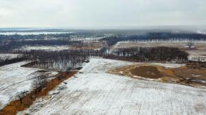 """alt=""""Aerial view with snow of 180-acre research project area at Grant Woods in Ingleside, Ill."""""""