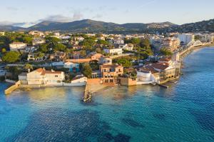 The magic of Saint-Tropez is magnified in Villa La Saudade, a once in a generation oceanfront property to come on the market, with private beach frontage and three boat moorings.