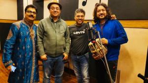 picture of four artists in studio