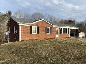 3 bedroom 2 bath brick ranch home measures 1,968± sf. (984± finished sf. main level and 984± finished sf. basement) and features a kitchen/dining area (conveying appliances); living room; finished walk-out basement; attic w/pull down stairs; and attached brick carport