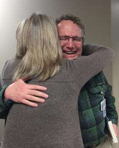 Lori Dultmeier giving a hug to the surgeon who tried to save her daughter 19 years ago