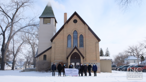 """<img src=""""image10.png"""" alt=""""Group photo of Ministers and members of Iglesia Ni Cristo outside newly purchased chapel in Neepawa, Manitoba, Canada"""" />"""