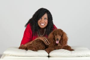 A photo of Denise Meridith, President of Read to Kids US, and her poodle Arry
