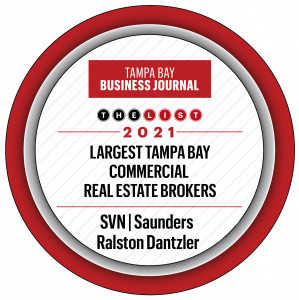 A graphic badge of the TBBJ Top CRE Brokerages 2021 award winner