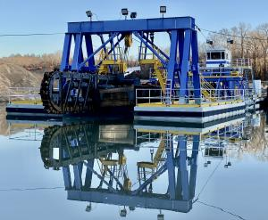 """Front view of a 14"""" Electric Chain-Ladder Cutter Suction Dredge"""