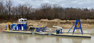 Side view of the Winter Bros new electric Chain-Ladder dredge designed and built by Custom Dredge Works