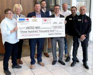 United Way of the Mid-Willamette Valley accepts a check from Capitol Auto Group
