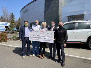 Capitol Auto Group presents $300,000 check to United Way of the Mid-Willamette Valley  at Capitol Subaru.  (L-R) Alex Casebeer, Scott and Carrie Casebeer, Matthew Casebeer, Bob Myers
