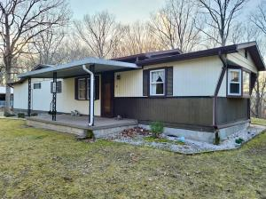2 BR/2 BA mobile home on a permanent foundation on .77± +/- acre lot -- Walk-out basement & 2 car attached garage -- Centrally located between Romney, WV, Keyser, WV & Cumberland, MD and only 20 minutes to I-68