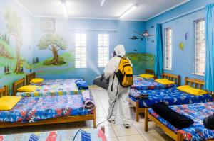Scientology Volunteer Ministers help protect children in orphanages and children's homes by sanitizing the facilities.