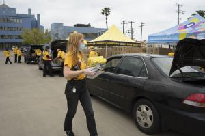 Volunteer Ministers placed food boxes in trunks of the cars that drove through the Church of Scientology parking lot.