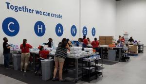 Volunteers repacking diapers at Texas Diaper Bank.