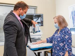 Dr. Gregory Kolovich, inventor of Micro C, takes x-rays of a patient at the point of care.