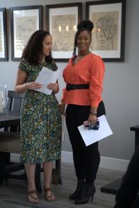 Scholarship Chair Tywanna Hill and Scholarship Committee Member Kristine Salib discuss meeting agenda