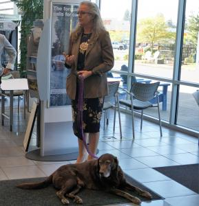 B.J. Anderson, Executive Director of the Willamette Humane Society and her dog Luke