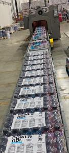 RCAAS interns at Bettaway learn various skills involved in running a warehouse, including operating systems like this automated variety pack line that assembles cases of beverages