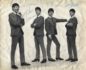 Vintage 8 inch by 10 inch photograph, featuring the Fab Four in their iconic, collarless suits, signed by all four Beatles