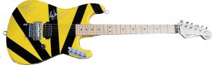 Charvel EVH Art Series electric guitar played by the late guitarist Eddie Van Halen during a concert in 2012, boldly signed by Van Halen.