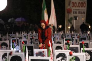Maryam Rajavi visits a memorial of the 30,000 victims of Iran's 1988 massacre of political prisoners outside France's National Assembly