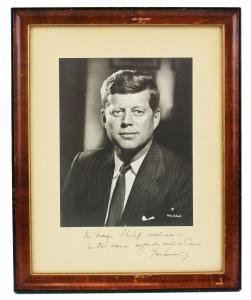 John F. Kennedy's signed and dedicated black and white photo of himself to Baltimore's mayor (est. $3,000-$3,500)..