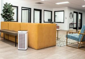 An image of a Medify Air purifier in an office lobby.