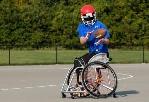 USA Wheelchair Football Player Catching the Ball