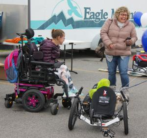 A youth in a wheelchair was surprised with her own sports equipment