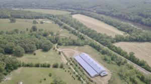 Bluebird Hill Farm is a 102.77± ac Albemarle County farm with a 3 bedroom 2 bath brick home, 2 high quality barns w/offices, equestrian center/arena w/office & living quarters, pastures, paddocks & fencing, 6 wells & multiple waterers and frontage on the James River