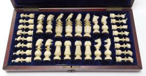 Immaculate, hand-carved Alaskan Inuit walrus ivory chess set, the pieces modeled after native fauna with exquisite calcification. Estimate: 3,000-$5,000.