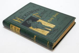 1885 first-edition copy of the Mark Twain classic book The Adventures of Huckleberry Fin. Estimate: $1,000-$1,500.