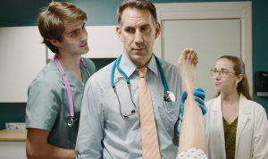 Creator-star Jerry Topitzer pits doctor versus evil insurance empire in the award-winning original comedy web series, UPCODE, officially premiering beginning June 8, 2021 on YouTube.