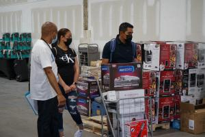 Volunteer Assists Family at The Big Giveaway