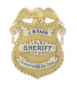 J.B. Farr's early 1900s 14kt gold presentation sheriff's badge, highly detailed, an important piece of Colorado history. Estimate: $8,000-$12,000.