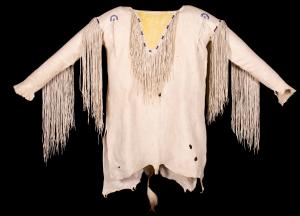Circa 1920-1930 Native American Kiowa tanned and sinew-sewn deer hide shirt with 17-inch-long fringe and decorative beadwork. Estimate: $7,000-$9,000.