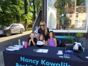 Trish Applegate from Nancy Kowalik Real Estate Group and her family were signing up contest entries.