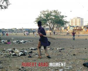 Two boys in Mumbai playing cricket in dirty field