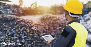 An in-field worker using the Diversys mobile app to record activity in a waste program.