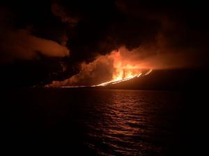 Galapagos volcano erupting at night