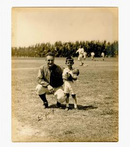 Circa 1933 photo of Lou Gehrig, shown posing with a young boy identified on verso as William Grice Bogg, signed by Gehrig (est. $3,000-$4,000).
