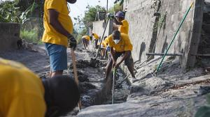 The Scientology Volunteer Ministers joined by local volunteers took on the task of cleaning out the blocked drainage lines of the Chateaubelair Hospital.